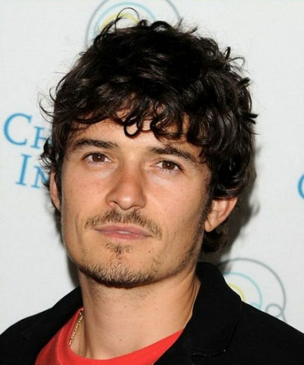 Medium curly hairstyle with bangs men