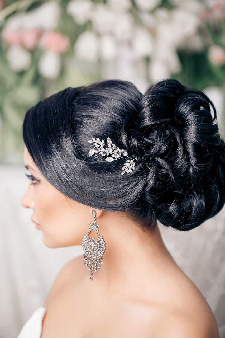 Fabulous Wedding day Bun Black Hairstyles for Bride black Hair with accessory 2017