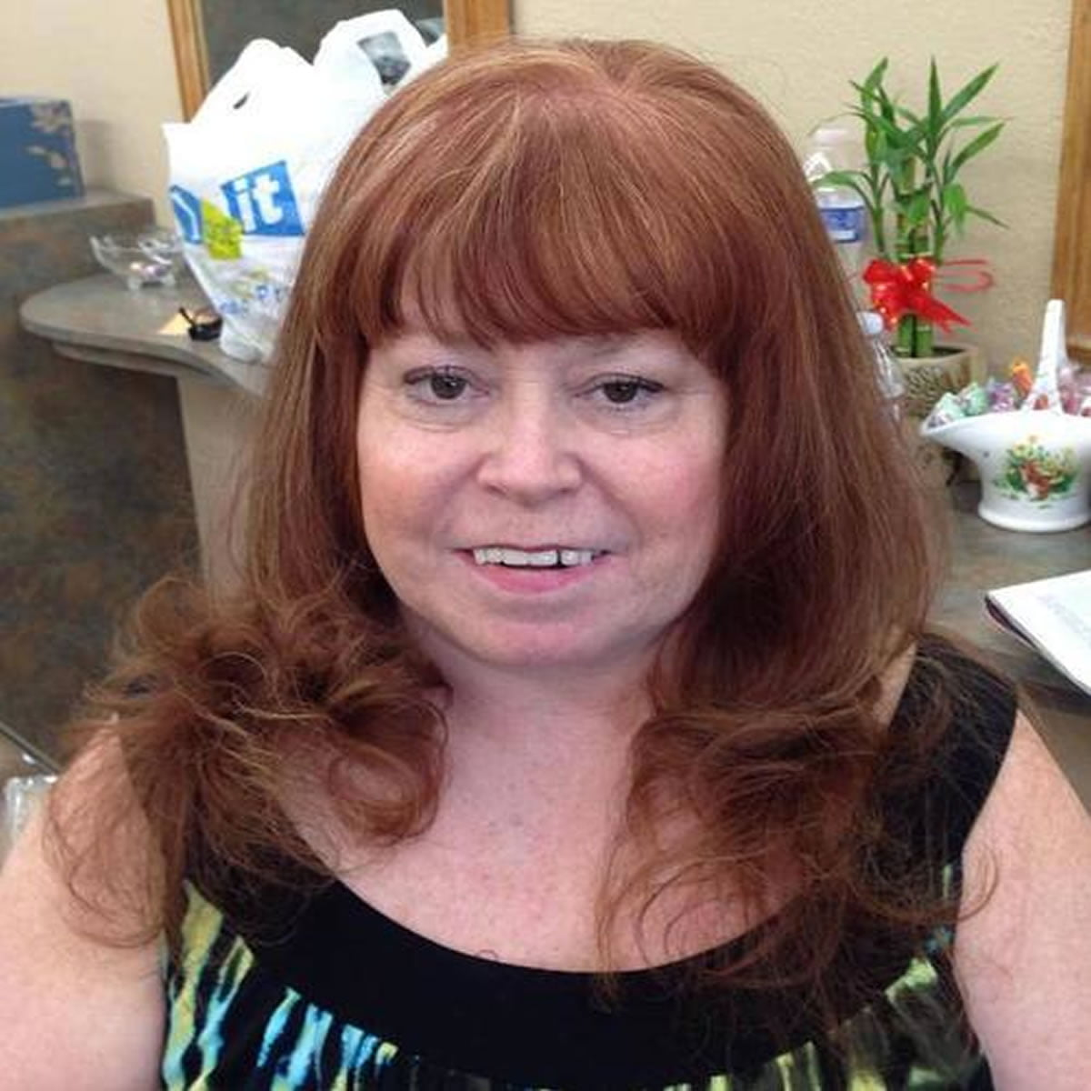 brown hair style with bangs for older women