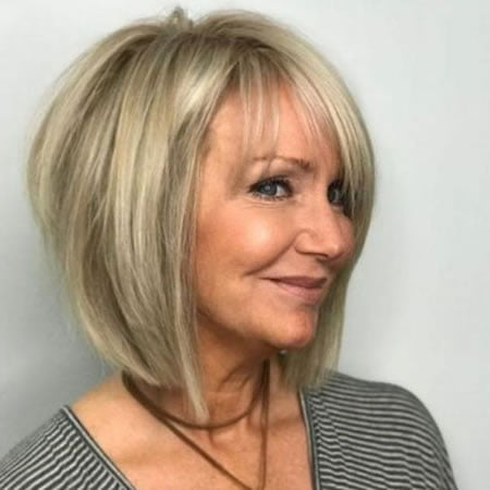 Angled short bob haircut for women over 60