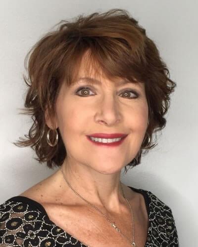 Layered short haircut over 60