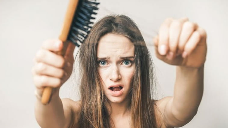 What causes hair loss in females